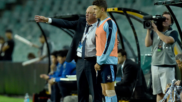 Graham Arnold gives instructions to young striker George Blackwood.