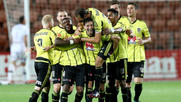 Phoenix players celebrate Vince Lia's goal against the Mariners.