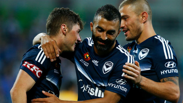 Victory's Marco Rojas, Fahid Ben Khalfallah and James Troisi celebrate a goal against Glory on Saturday night.