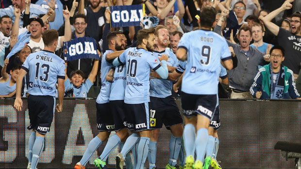 Sydney FC players celebrate one of David Carney's two goals in their win over Melbourne Victory.