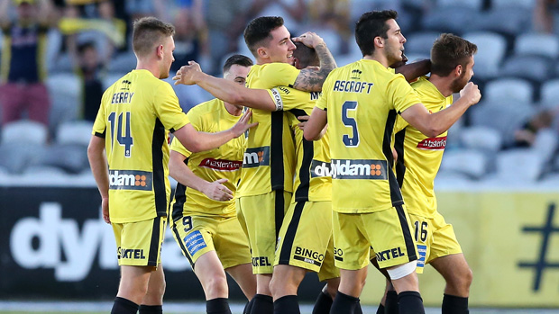 Mariners players celebrate a goal in their 2-0 win over Newcastle Jets on Sunday afternoon.