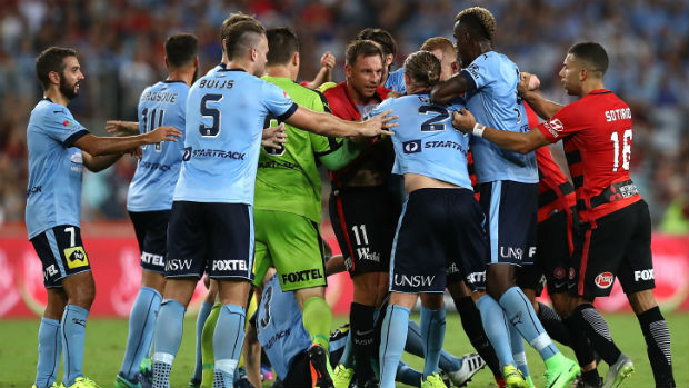 Sydney FC and Wanderers players come together in Saturday night's Sydney Derby.