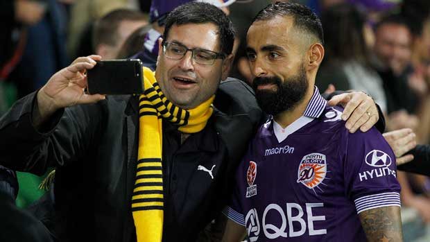 Spanish whiz Diego Castro poses for a selfie with a Perth Glory fan.