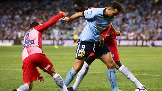 Sydney FC striker Bobo in a tussle with two Melbourne City defenders at Allianz Stadium.