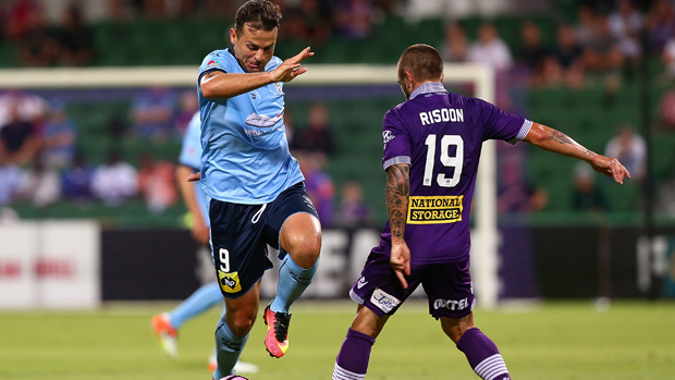 Sydney FC striker Bobo wins the ball ahead of Glory defender Josh Risdon.