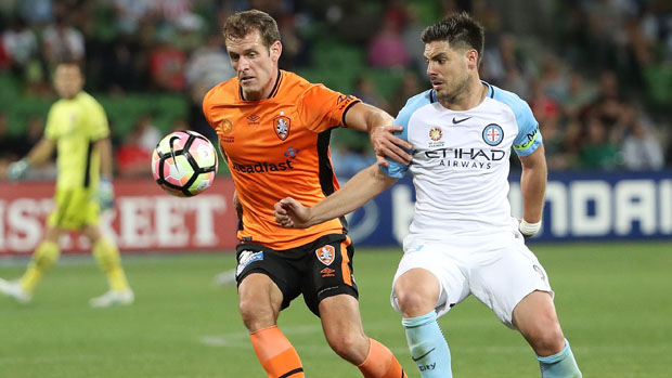 Roar defender Luke DeVere challenges for the ball with City captain Bruno Fornaroli.