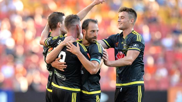 Wellington Phoenix players celebrate a goal in their 2-1 win over Brisbane Roar.
