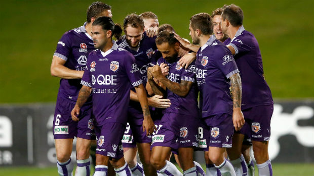 Perth Glory players celebrate Diego Castro's superlative equaliser against the Phoenix on Saturday.