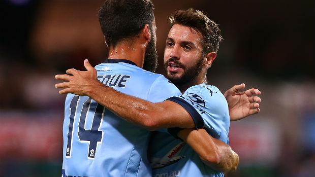 Sydney FC defender Michael Zullo hugs captain Alex Brosque.