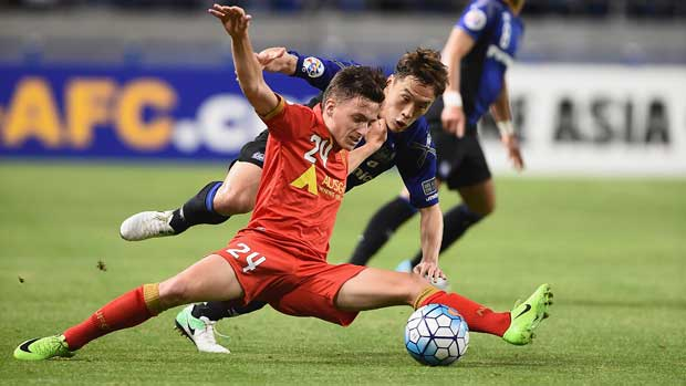 Adelaide youngster Jordan O'Doherty doing his best to keep the ball in the Reds' ACL clash with Gamba Osaka on Tuesday night.