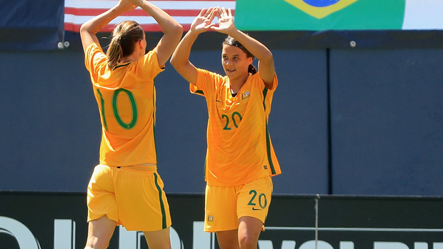Sam Kerr celebrates one of her three goals against Japan at the Tournament of Nations.