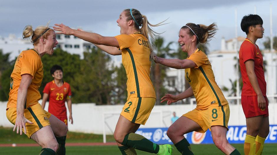 Westfield Matildas players celebrate with Ellie Carpenter after her late winner.