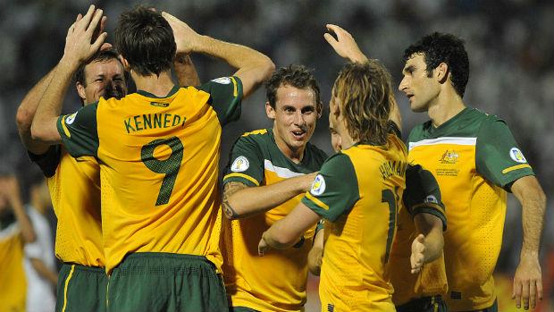 The Socceroos celebrate Josh Kennedy scoring against Saudi Arabia in 2011.