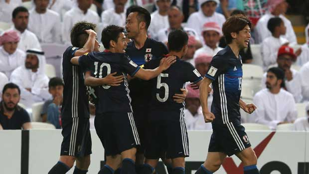 Japan players celebrate a goal in their win over UAE.