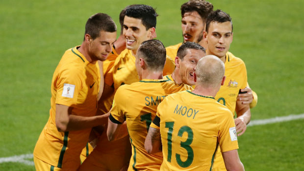 The Caltex Socceroos celebrate Tomi Juric scoring against Iraq in World Cup qualifying.