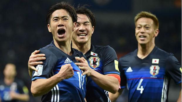 Japan's Shinji Kagawa, Shinji Okazaki and Keisuke Honda celebrate a goal in World Cup qualifying.