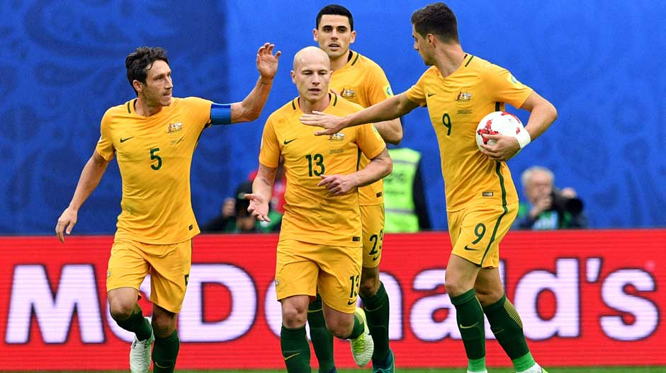 Caltex Socceroos players celebrate the equaliser.