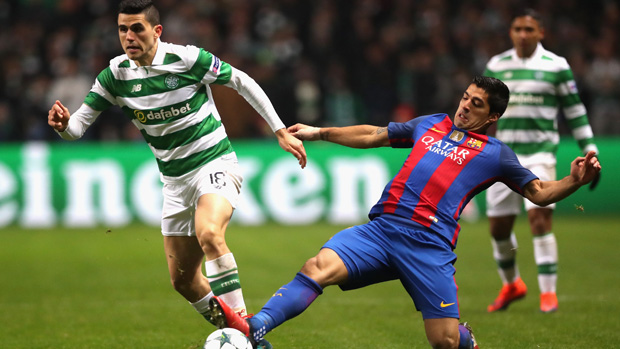 Tom Rogic is challenged by Barcelona superstar Luis Suarez in the UEFA Champions League.
