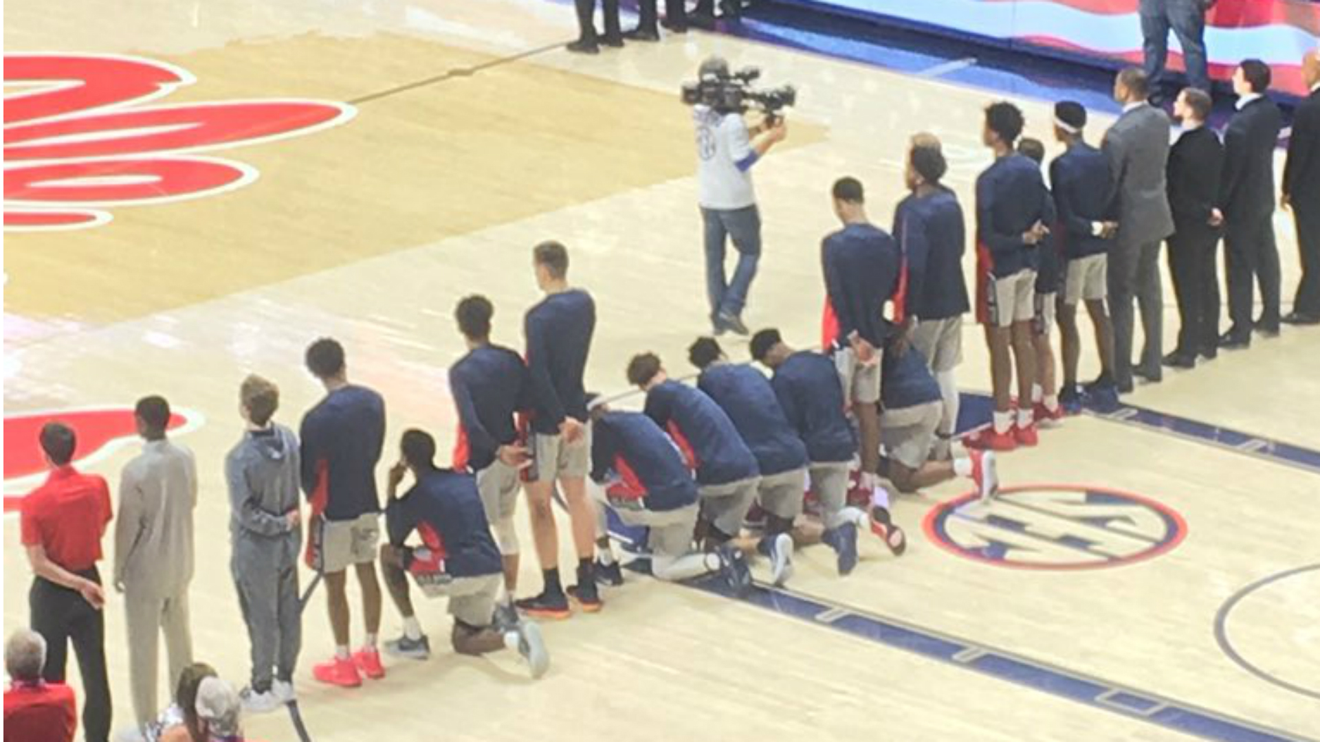 Image result for ole miss basketball players kneel