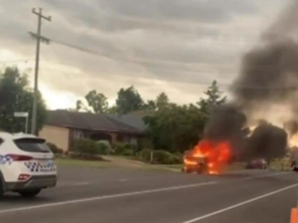 A police car blocks the road while the ute is on fire in a street in Hoppers Crossing in outer-Melbourne. Credit: Facebook