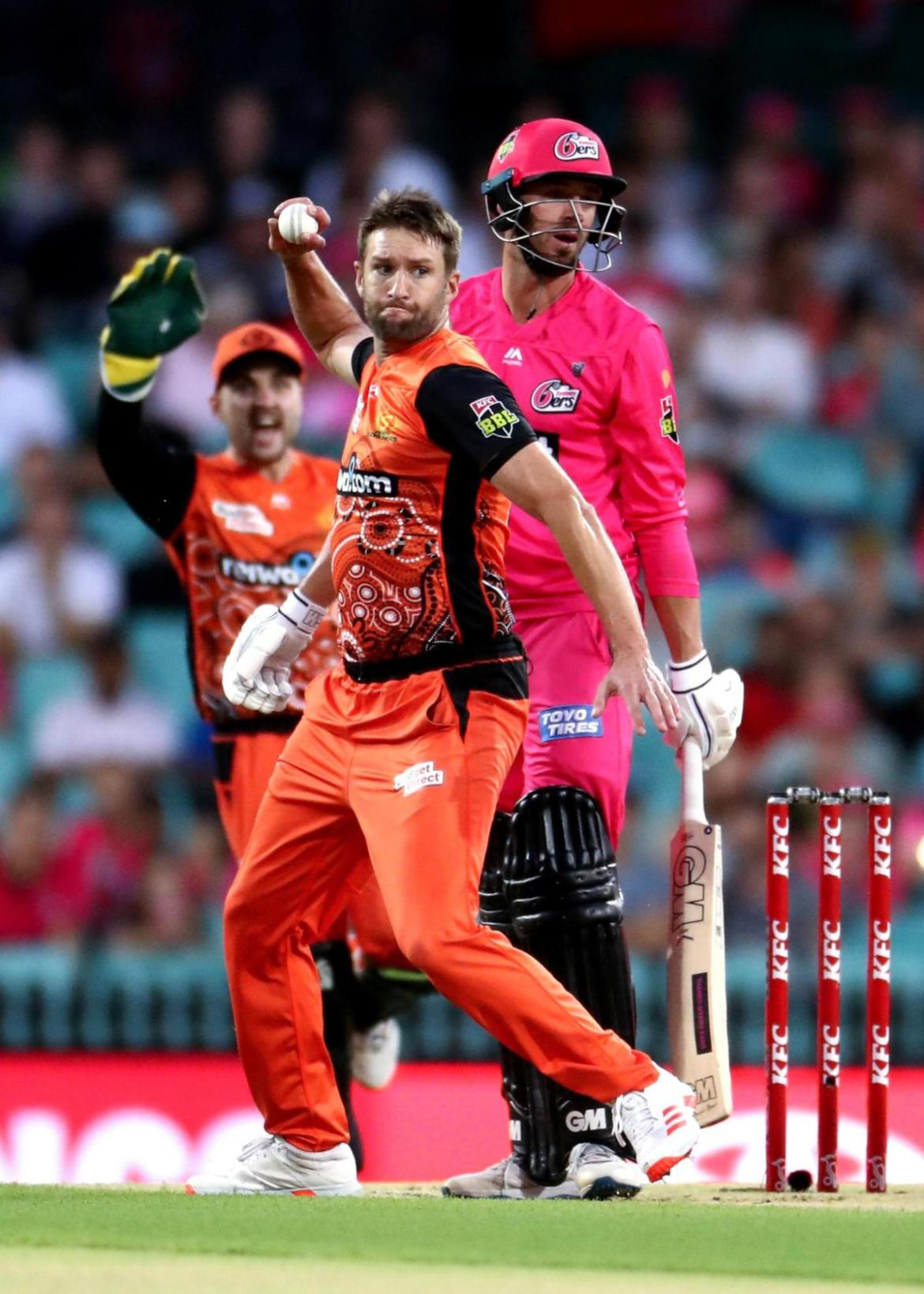 SYDNEY, AUSTRALIA - FEBRUARY 06: Andrew Tye of the Scorchers runs out Josh Philippe of the Sixers during to the Big Bash League Final match between the Sydney Sixers and the Perth Scorchers at the Sydney Cricket Ground on February 06, 2021 in Sydney, Australia. (Photo by Brendon Thorne/Getty Images)