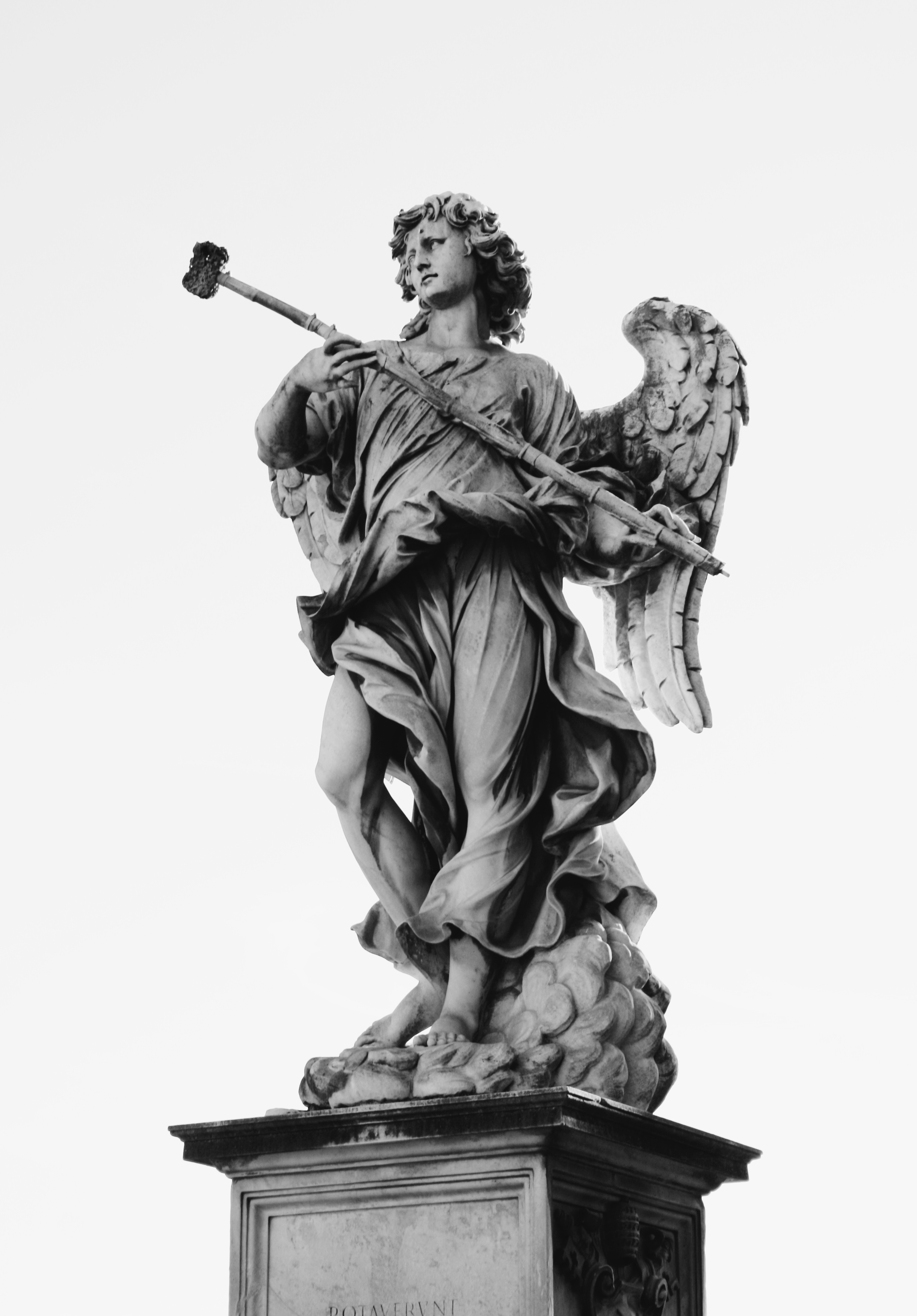 Grayscale Of Angel Statue Under Cloudy Skies