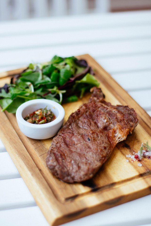 Shallow Focus Photography of Meat Dish and Leaves