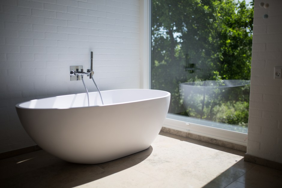 White Ceramic Bathtub Beside Clear Glass Wall