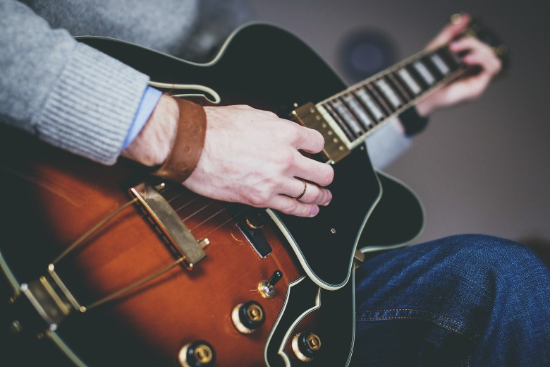 person playing guitar · free stock photo