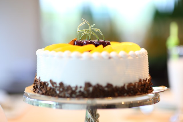 White Round Cake Topped With Yellow Slice Fruit