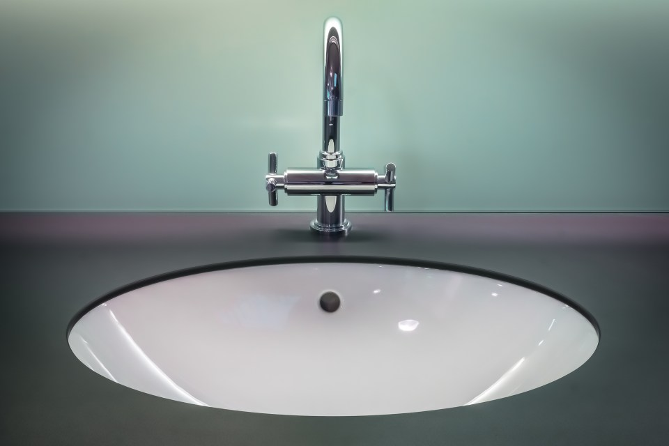 Black and White Vanity Top With Stainless Steel Faucet