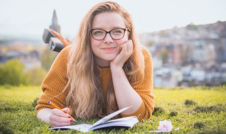 girl writing on her notebook