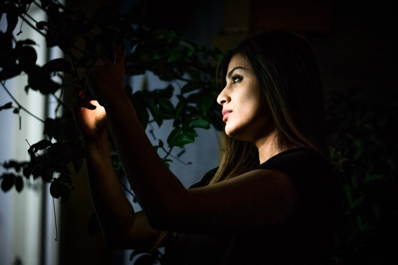 Low-light Photo of Woman Holding Light