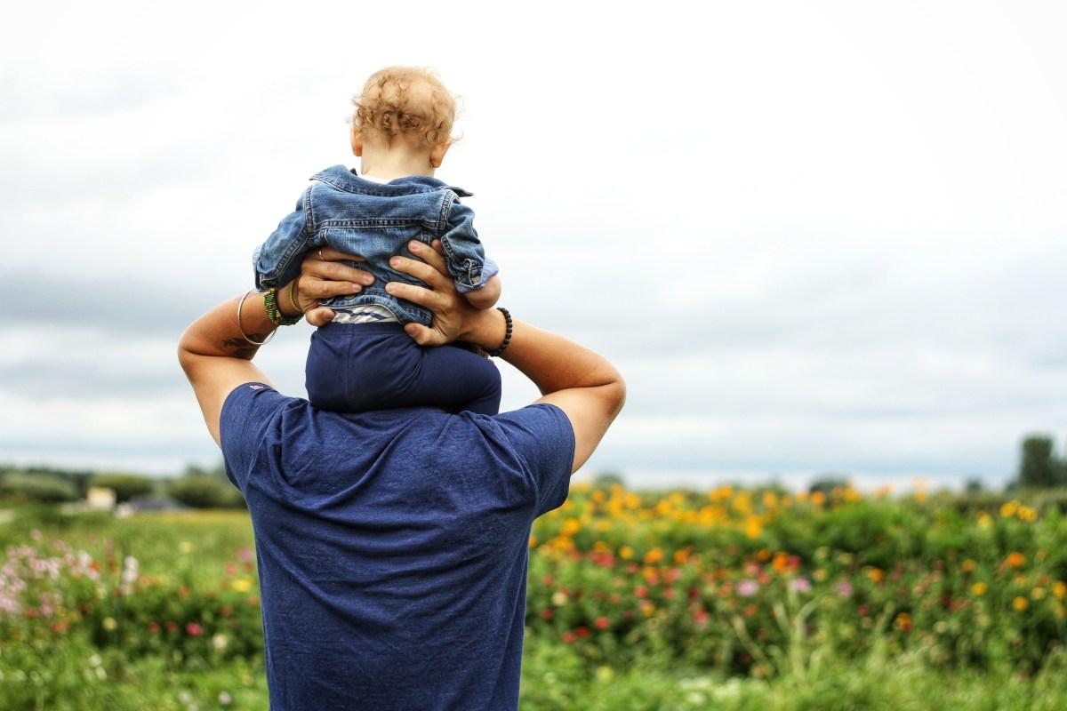 Baby Sitting on Man's Shoulder