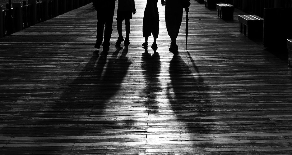 Silhouette of 4 Person Walking  Free Stock Photo