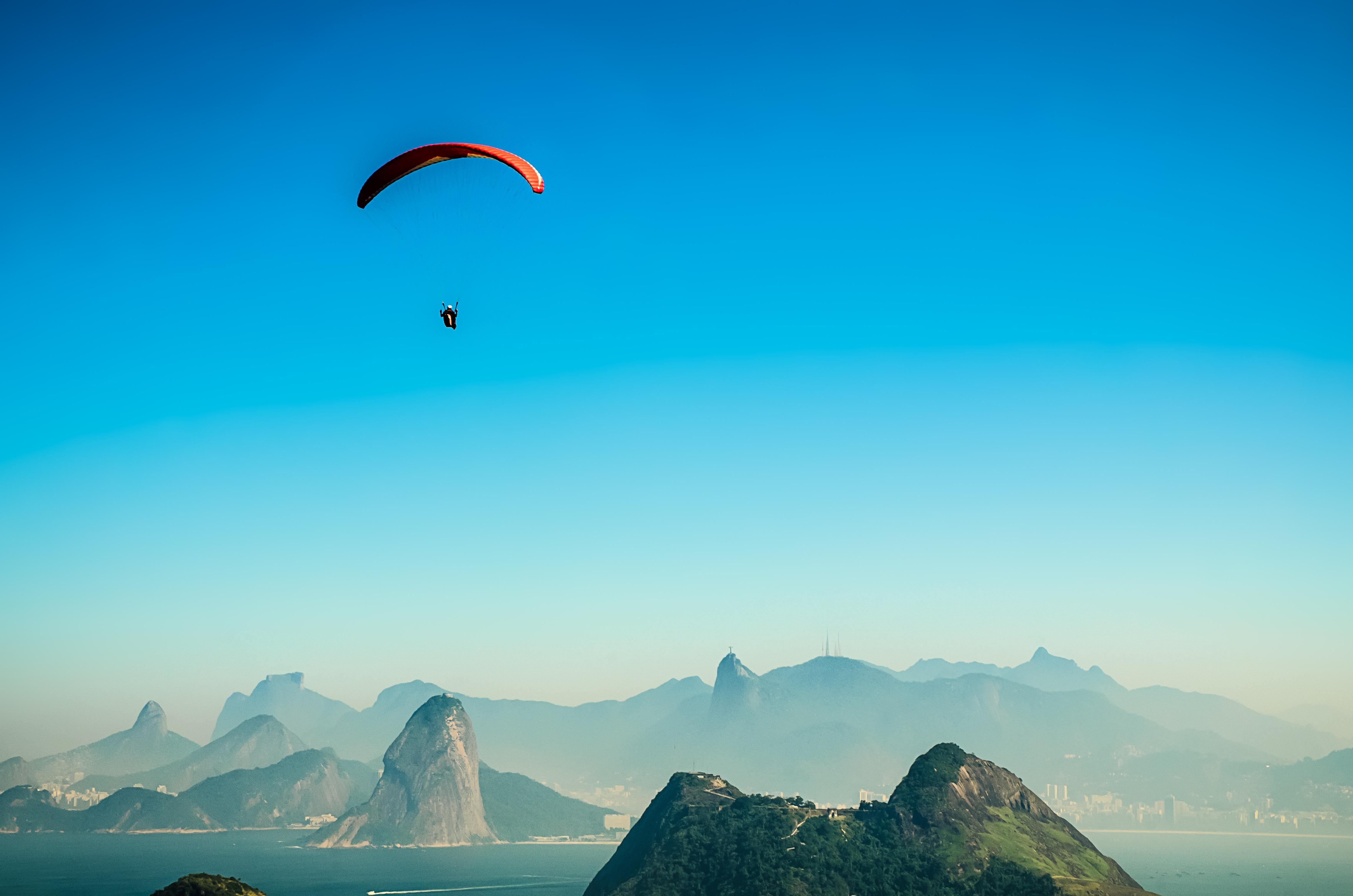 Rio De Janeiro Wallpaper Iphone Person In Parachute Gliding Above Mountains 183 Free Stock Photo