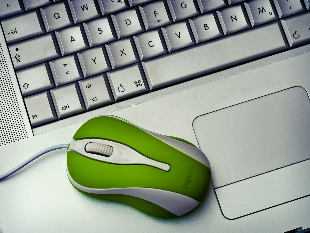 Green Mouse on silver Laptop