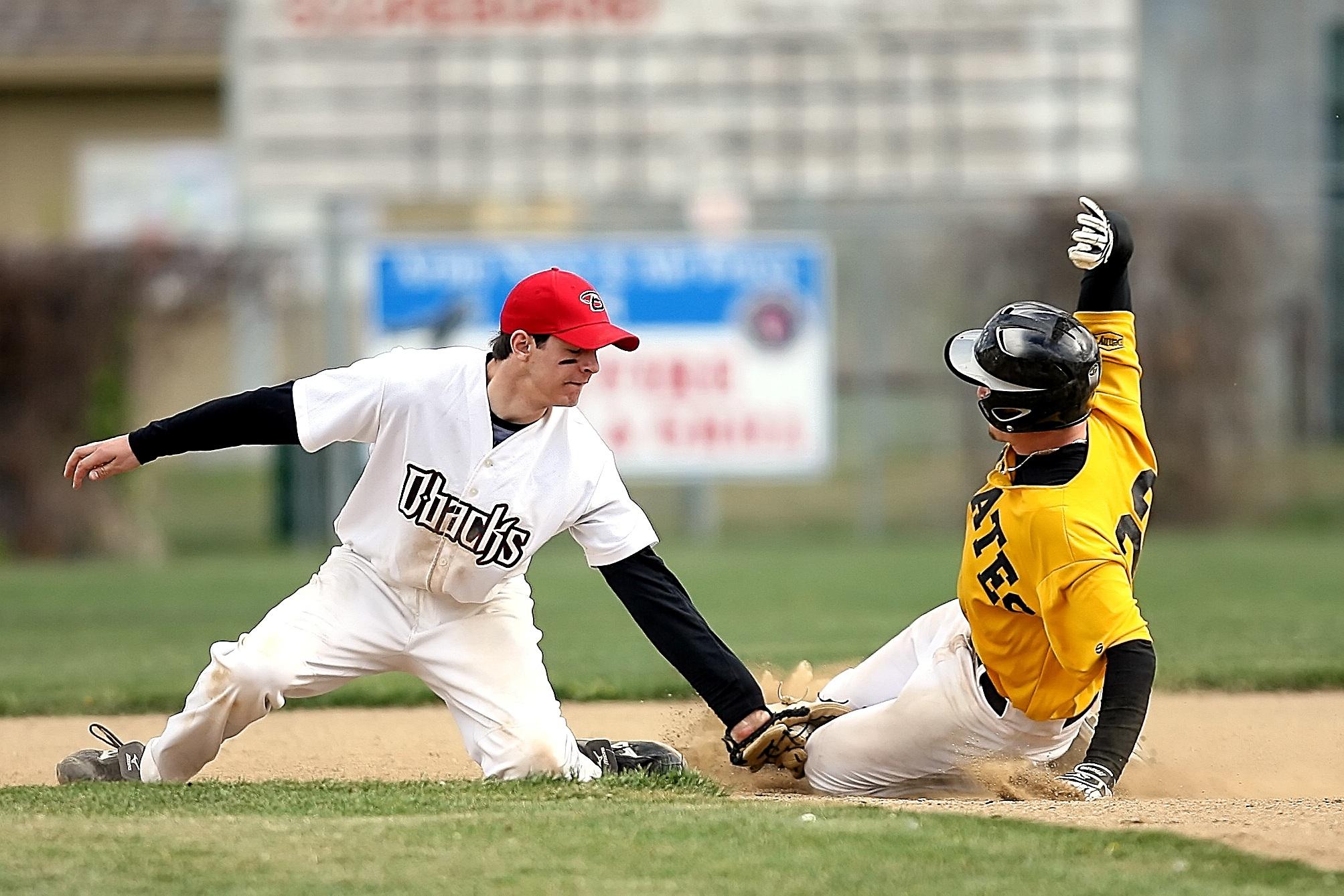 Baseball Player Wearing Blue And White Jersey Catching Baseball Free Stock Photo