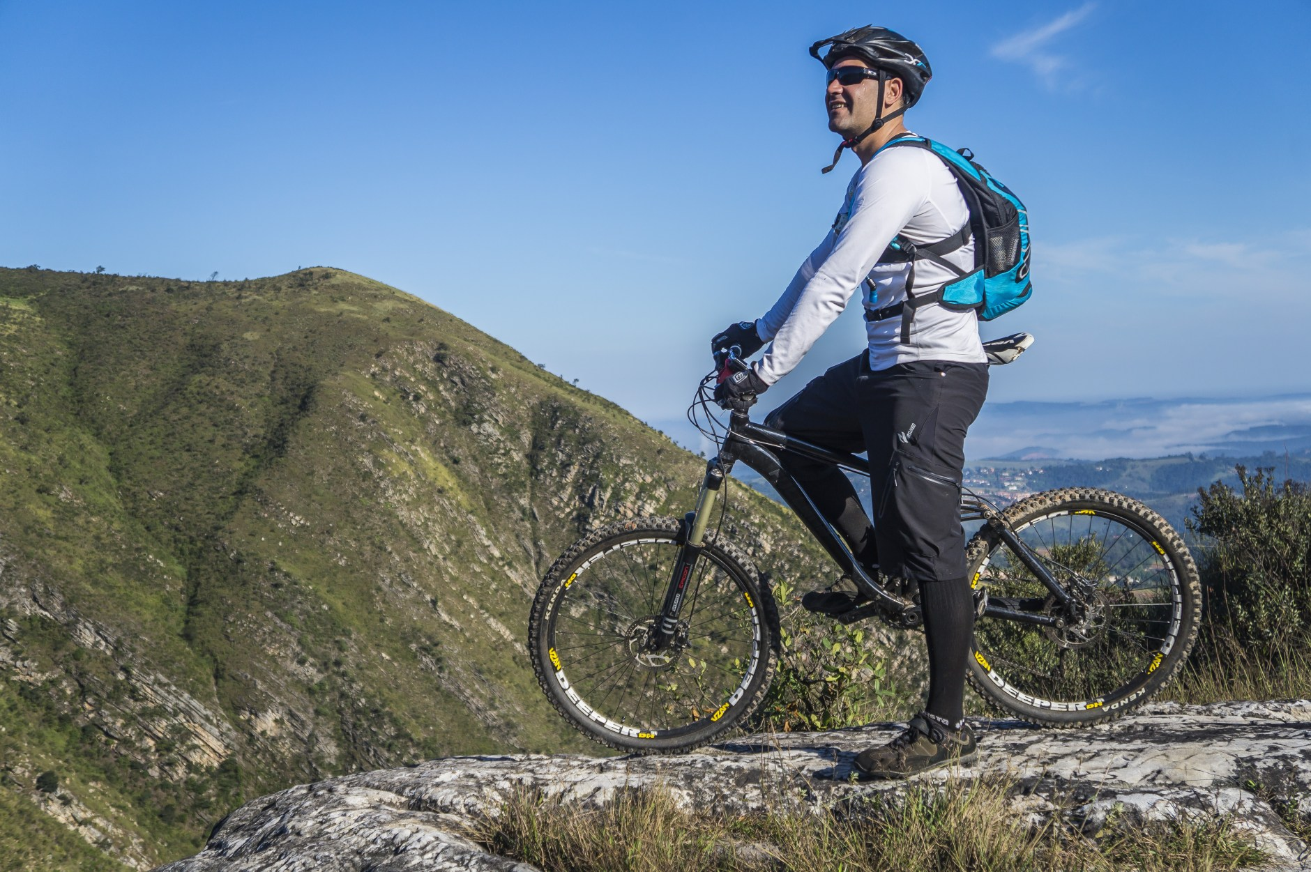 man with bike in the mountain