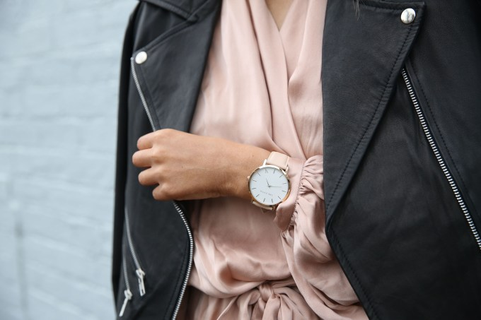 Woman Wearing Peach Dress and Black Jacket's Left Hand Closeup Photography