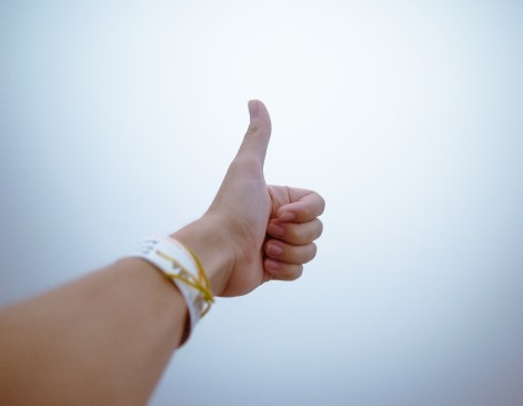 person who may be a client doing thumbs up