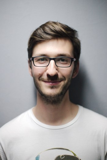Man Smiling Behind Wall