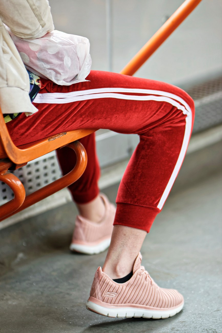 person wearing red jogging pants