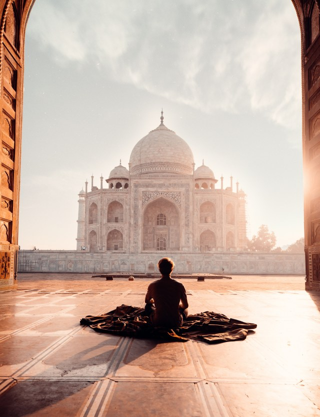 Person Sitting in Front of the Taj Mahal world peace in india