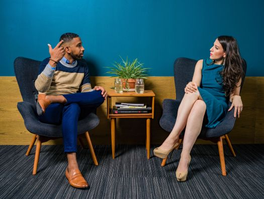 Woman Talking to Man about Interpersonal Skills