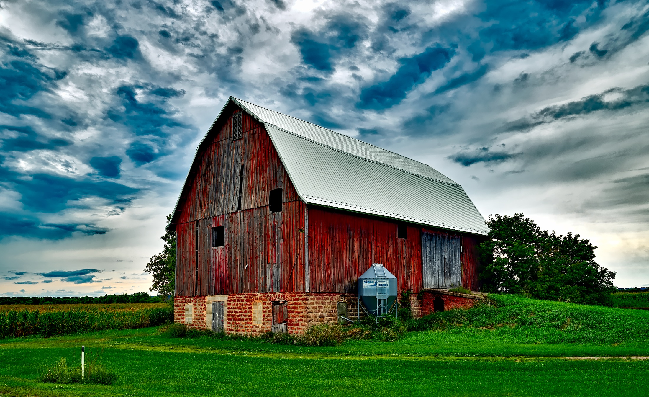 Houses in Farm Against Cloudy Sky  Free Stock Photo