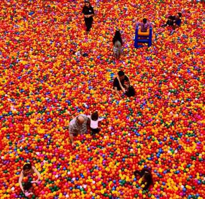 People Playing At The Ball Pit