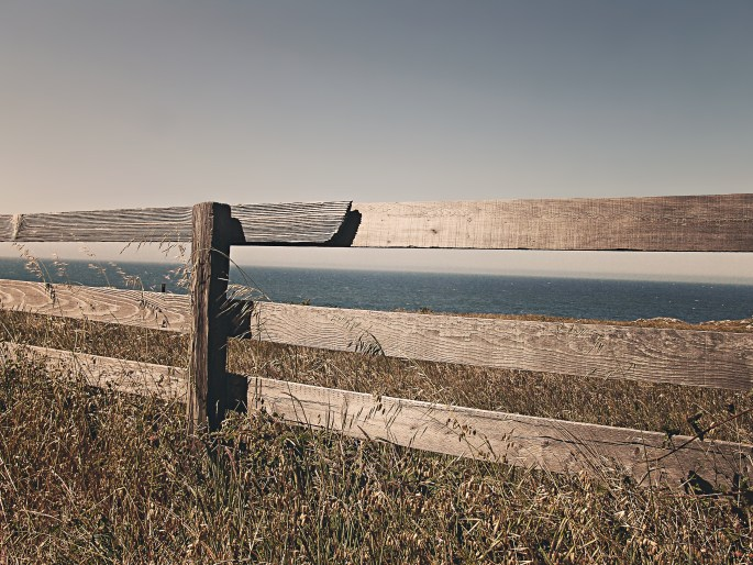 Brown Wooden Fence Near Body of Water
