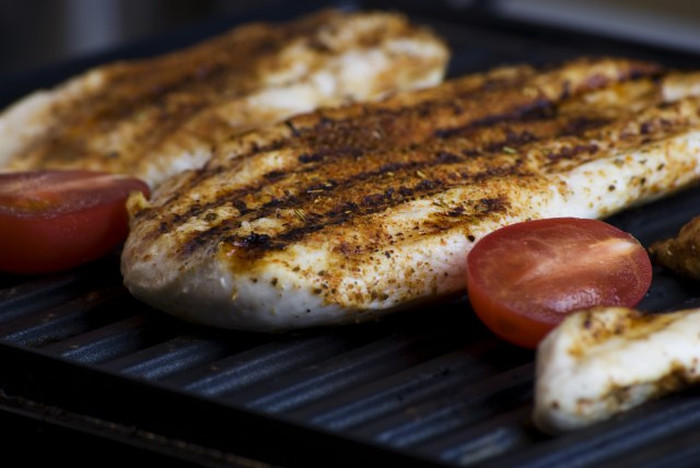 Selective Focus Photography of Grilled Slice of Meat and Tomatoes