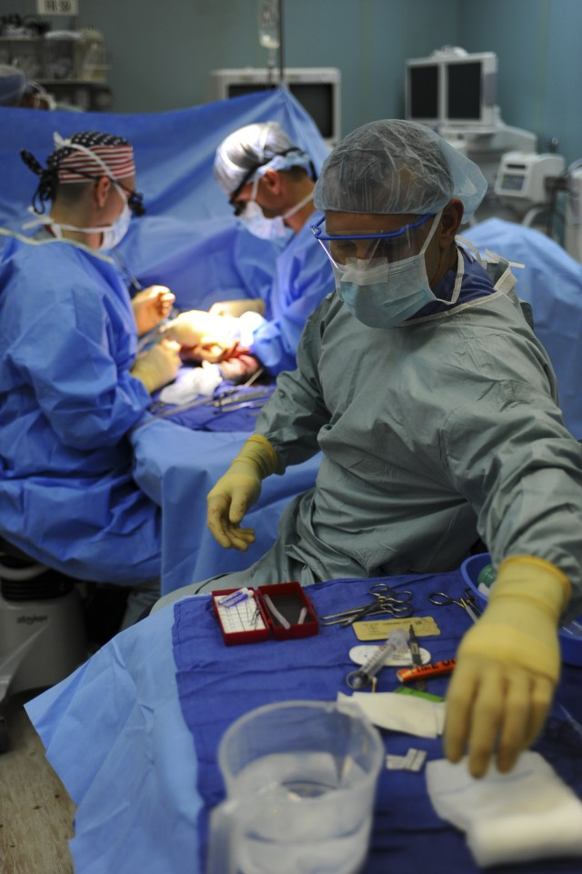 Group of Doctors Doing Operation Inside Room